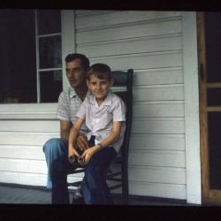 Man and woman sitting on porch bench
