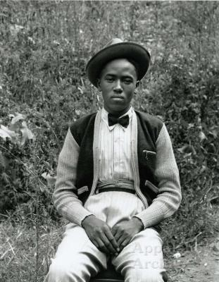 Exterior portrait of young man in hat