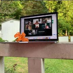 Monitor on porch railing displays virtual meeting
